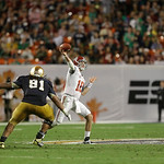 Alabama quarterback AJ McCarron (10) works as Notre Dame defensive end Sheldon Day (91)defends during the second half of the BCS National Championship college football game Monday, Jan. 7, 2 …