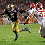 Notre Dame quarterback Everett Golson (5) runs past Alabama's Xzavier Dickson (47) and Trey DePriest (33) for a touchdown during the second half of the BCS National Championship college foot …
