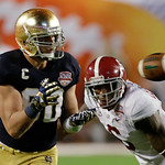 Notre Dame's Tyler Eifert (80) catches a pass in front of Alabama's Ha'Sean Clinton-Dix (6) during the second half of the BCS National Championship college football game Monday, Jan. 7, 2013 …