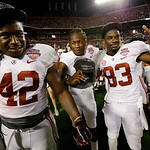 Alabama 's Eddie Lacy (42), Kenny Bell (7) and Kevin Norwood (83) celebrate after the BCS National Championship college football game against Notre Dame Monday, Jan. 7, 2013, in Miami. Alaba …