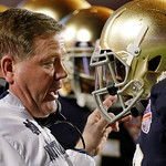 Notre Dame head coach Brian Kelly talks to Robby Toma during the first half of the BCS National Championship college football game against Alabama Monday, Jan. 7, 2013, in Miami. (AP Photo/C …