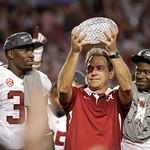Alabama head coach Nick Saban holds up the championship trophy after the BCS National Championship college football game against Notre Dame Monday, Jan. 7, 2013, in Miami. Alabama won 42-14. …