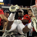 Fans pull Alabama's Landon Collins into the seats after the BCS National Championship college football game against Notre Dame Monday, Jan. 7, 2013, in Miami. Alabama won 42-14. (AP Photo/Ch …