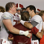 Alabama head coach Nick Saban is hugged by AJ McCarron and Barrett Jones after the BCS National Championship college football game against Notre Dame Monday, Jan. 7, 2013, in Miami. Alabama  …