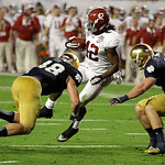 Alabama's Eddie Lacy spins past Notre Dame's Dan Fox (48) and Danny Spond for a touchdown during the first half of the BCS National Championship college football game Monday, Jan. 7, 2013, i …