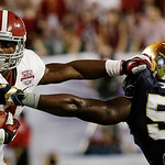 Alabama's T.J. Yeldon tries to get past Notre Dame's Prince Shembo (55) during the first half of the BCS National Championship college football game Monday, Jan. 7, 2013, in Miami. (AP Photo …
