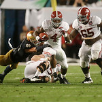 Alabama running back T.J. Yeldon (4) runs against Notre Dame during the first half of the BCS National Championship college football game Monday, Jan. 7, 2013, in Miami. (AP Photo/John Bazem …