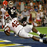 Alabama's Eddie Lacy falls into the end zone for a touchdown during the first half of the BCS National Championship college football game against Notre Dame Monday, Jan. 7, 2013, in Miami. ( …