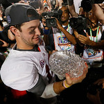 Alabama's AJ McCarron holds The Coaches Trophy after the BCS National Championship college football game against Notre Dame Monday, Jan. 7, 2013, in Miami. Alabama won 42-14. (AP Photo/John  …