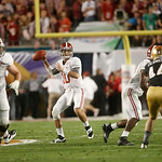 Alabama quarterback AJ McCarron (10) works against Notre Dame during the first half of the BCS National Championship college football game Monday, Jan. 7, 2013, in Miami. (AP Photo/John Baze …