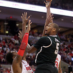 Michigan State's Adreian Payne, top, shoots between Ohio State's Deshaun Thomas, left, and Amir Williams during the second half of an NCAA college basketball game Sunday, Feb. 24, 2013, in C …