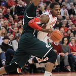 Ohio State's Deshaun Thomas, right, dribbles around Michigan State's Adreian Payne during the first half of an NCAA college basketball game Sunday, Feb. 24, 2013, in Columbus, Ohio. (AP Phot …