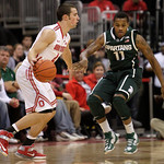 Ohio State's Aaron Craft, left, looks for an open pass as Michigan State's Keith Appling defends during the second half of an NCAA college basketball game Sunday, Feb. 24, 2013, in Columbus, …
