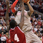Ohio State's Deshaun Thomas, top, shoots over Indiana's Victor Oladipo during the first half of an NCAA college basketball game on Sunday, Feb. 10, 2013, in Columbus, Ohio. (AP Photo/Jay LaP …