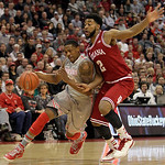 Ohio State's Lenzelle Smith, left, drives to the basket against Indiana's Christian Watford during the first half of an NCAA college basketball game on Sunday, Feb. 10, 2013, in Columbus, Oh …