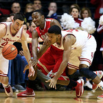 Indiana's Will Sheehey, left, and Jeremy Hollowell, right, battle for a loose ball against Ohio State's Sam Thompson during the first half of an NCAA college basketball game, Tuesday, March  …
