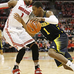 Ohio State's DeShaun Thomas, left, tries to slow down Michigan's Glenn Robinson III, right, during the second half of an NCAA college basketball game on Sunday, Jan. 13, 2013, in Columbus, O …