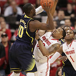 )Ohio State's Lenzelle Smith Jr. (32) tries to block a shot by Michigan's Tim Hardaway Jr. (10) during the first half of an NCAA college basketball game on Sunday, Jan. 13, 2013, in Columbus …