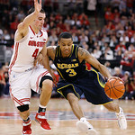 Ohio State's Aaron Craft (4) stays close to Michigan's Trey Burke during the second half of an NCAA college basketball game Sunday, Jan. 13, 2013, in Columbus, Ohio. Ohio State won 56-53. (A …