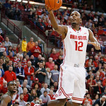 Ohio State's Sam Thompson (12) scores after a steal against Michigan during the first half of an NCAA college basketball game Sunday, Jan. 13, 2013 in Columbus, Ohio. Ohio State won 56-53. ( …