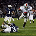 ** CORRECTS ID TO RUNNING BACK BRANDON SAINE, NOT QUARTERBACK TERRELLE PRYOR ** Ohio State running back Brandon Saine (3) dives into the end zone for a touchdown after breaking a tackle atte …