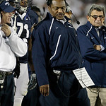 Penn State head coach Joe Paterno, right, frowns as he looks at assistant coaches Larry Johnson, center, and Tom Bradley, left, during the second half of an NCAA college football game agains …