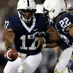 In this Saturday, Nov. 7, 2009 photo, Penn State quarterback Daryll Clark (17) hands off to running back Evan Royster (22) during the second half of an NCAA college football game against Ohi …