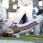 Ohio State quarterback Terrelle Pryor lands in the end zone for a touchdown against Penn State during the first half of an NCAA college football game in State College, Pa., Saturday, Nov. 7, …