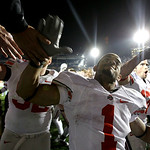Ohio State's Daniel Herron (1) and members of the Ohio State team celebrate a 24-7 win over Penn State with their student section after an NCAA college football game in State College, Pa., S …