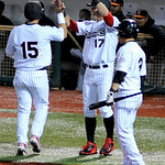Lake Erie's Emmanuel Quiles (15) is greeted at home plate by Seth Granger after