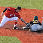 Lake Erie Crushers' second baseman Adam Ford tags for Normal CornHuskers' Richard Lucas.  KRISTIN BAUER | CHRONICLE