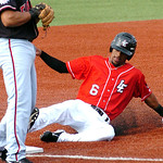 The Crushers' #6 Kevin Berard slides safely into third.