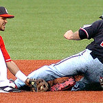 Freedom's #12 Eric Groff slides safely into second just past the tag of Crusher's #32 Juan Sanchez.