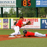 Crushers second baseman Vincent Mejia goes for the out against Freedoms' Cole Miles. AMANDA K. RUNDLE/CHRONICLE
