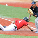 Lake Erie Crushers' Joey Burney slides safely back into first as Windy City ThunderBolts' first baseman Davidson Peguero attempts to pick him off.  KRISTIN BAUER   CHRONICLE
