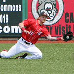 Lake Erie Crushers left fielder Adam Ford makes a diving catch for an out in the second inning. ANNA NORRIS/CHRONICLE
