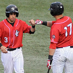 Lake Erie Crushers' Seth Granger, right, congratulates teammate Trevor Stevens on scoring a run. KRISTIN BAUER | CHRONICLE