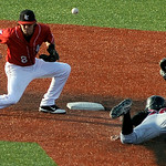 Lake Erie Crusher's second baseman Matt Dickason misses a ball to tag out Washington Wild Things' Daniel Poma. KRISTIN BAUER | CHRONICLE