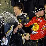 Jamie McMurray, right, sprays champagne in victory lane after winning the Daytona 500 NASCAR auto race at Daytona International Speedway in Daytona Beach, Fla., Sunday, Feb. 14, 2010. (AP Ph …