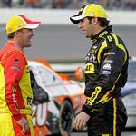 Kevin Harvick, left, talks with Elliott Sadler, right, during the second red flag delay in the NASCAR Daytona 500 auto race at Daytona International Speedway in Daytona Beach, Fla., Sunday,  …