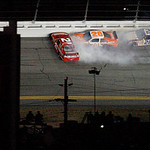 Joey Logano (20) and Boris Said (26) collide with Bill Elliott (21) in the closing laps of the NASCAR Daytona 500 auto race at Daytona International Speedway in Daytona Beach, Fla. Sunday, F …