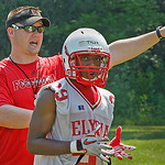Elyria  Defensive backs Coach Chad Heuser teaches his charges how they should respond to various offensive formations.  Photo by Tom Mahl