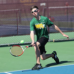Singles runner-up Amherst's Cory Habecker makes a nice get in the final match at the SWC tennis tournament. RAY RIEDEL/CHRONICLE