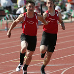 Lutheran West's Nicholas Knudsen hands off to Hunter Ross in the 4x200m prelim at the OHSAA state championship. photo by Ray Riedel