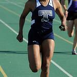 Lamia Scott of Lorain anchors the girls 4X200 meter relay. STEVE MANHEIM/CHRONICLE