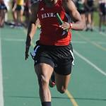 Zachary Robinson of Elyria anchors the boys 4X200 meter relay. STEVE MANHEIM/CHRONICLE