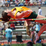 Erin Kasper of Amherst clears the bar in high jump at the OSHAA state track meet in Columbus. photo by Ray Riedel