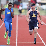 "Paul Sonego, right, of North Ridgeville battles ""N Man"" Jamiel Trimble of Cincinnati to the finsh of the 4x100m prelim race at the OSHAA state track meet in Columbus. photo by Ray Riedel"