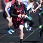 Avon Lake's David Winkel takes the baton on the way to a 2nd place finish in the 4x400m at the Avon Lake Invitational Meet. photo by Ray Riedel