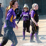 Vermilion's #11 Jessie Mello crosses home plate safely as Avon Pitcher #3 Anna Edwards and catcher #18 Emily Rogers wait for the ball.